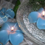 blue orchids floating pool candles design ideas