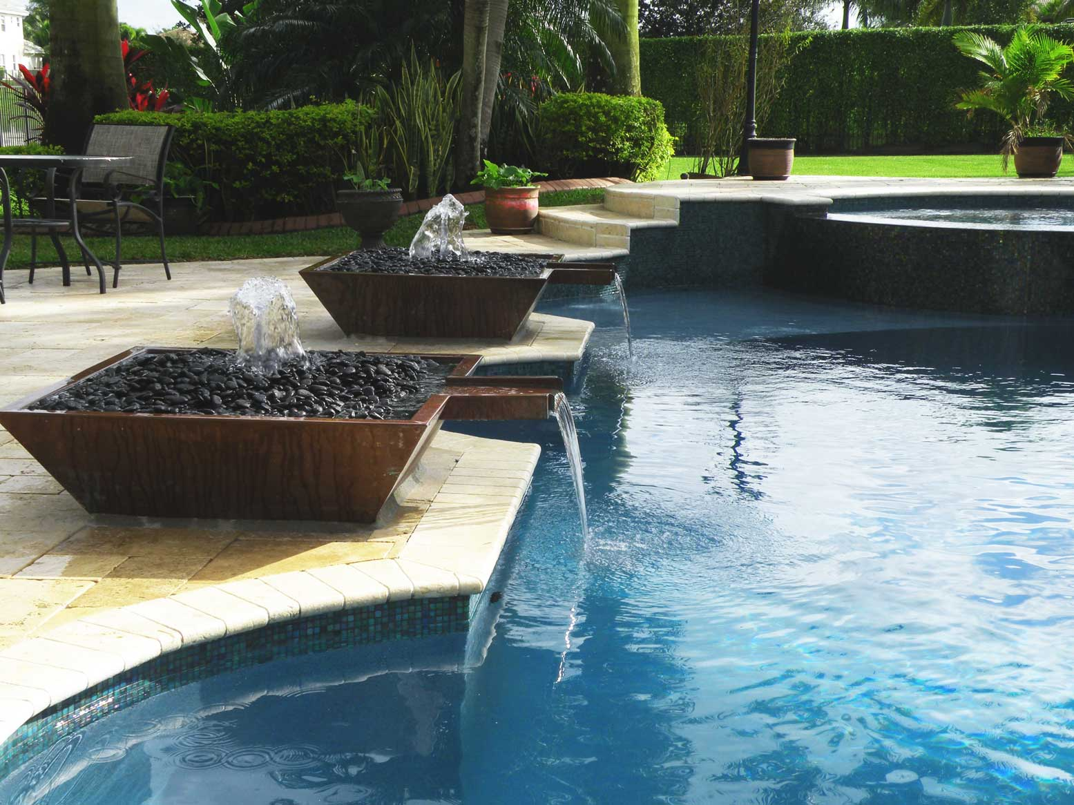 Outdoor swimming pool water fountain design ideas home for Pool exterior design